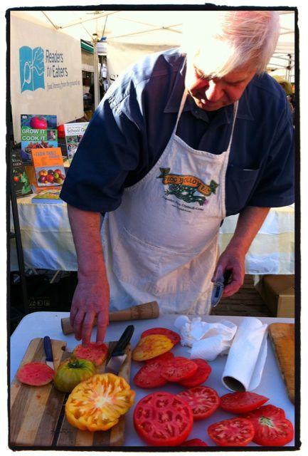 Jon Rowley demonstrating how to use a refractometer to gauge the level of sugars in tomatoes.