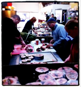 Volunteers washed, trimmed, and cut the tuna into chunks for canning.