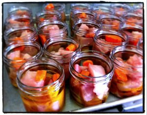 "Tuna in jars, ready to be processed. The ""secret"" ingredient is a slice of carrot for sweetness."